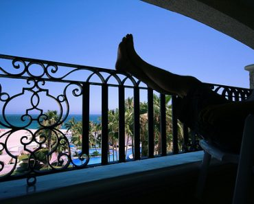 4726679274_d196c2c26e_relaxing-on-the-balcony